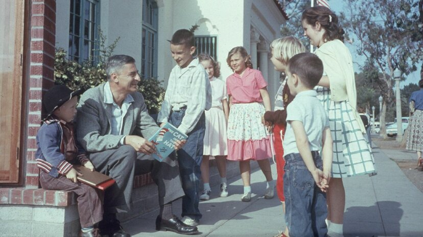 "Theodor Geisel, aka Dr. Seuss, holds his book ""The Cat in the Hat"" as he talks to a group of children. Gene Lester/Getty Images"