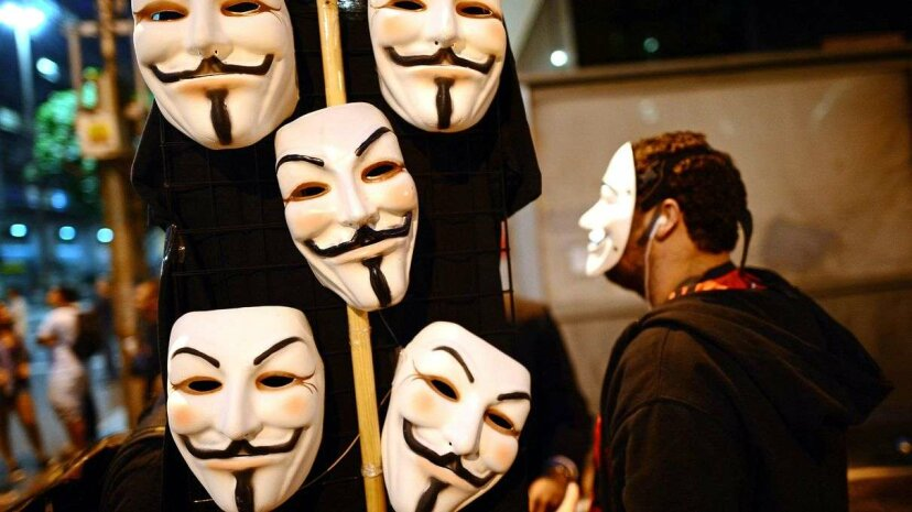 A vendor hawks Guy Fawkes' masks in the streets of Rio in July 2013, as Brazilian workers marched for better work conditions. Fawkes' likeness has been appropriated by all sorts of groups, including Anonymous. ChristopheSimon/AFP/GettyImages