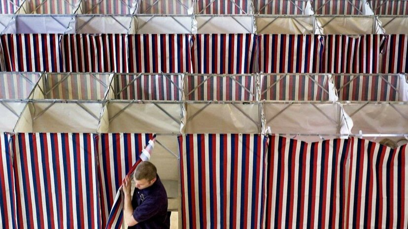 A man leaves a booth after voting at Kennebunk Town Hall  in Portland, Maine. In addition to the state primaries and bond issues, Kennebunk residents voted on school budget expenditures, a non-binding referendum question to prohibit casinos in the town... Gregory Rec/Portland Press Herald via Getty Images