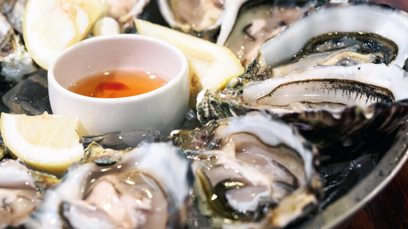 Despite what you may have heard, it's safe to eat raw oysters year-round, as long as you know where they were harvested. Kelvin Kam/EyeEm/Getty Images