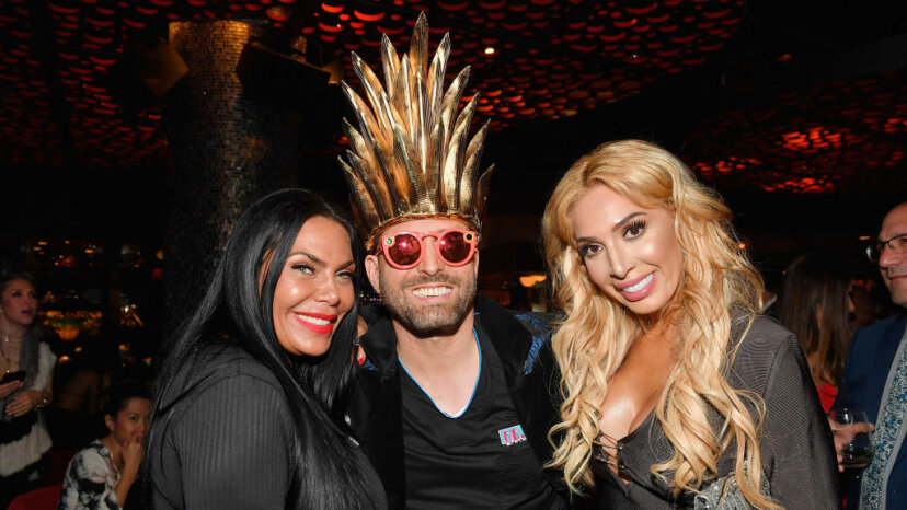 'Dr. Miami' Michael Salzhauer (standing between reality personalities Renee Graziano, left, and Farrah Abraham) attends WE tv's premiere party for the new show 'Dr. Miami' at the Tuck Room in North Miami Beach on March 30, 2017.  Salzhauer has come under fire for his outrageous plastic surgery Snapchat videos, but they also helped him land a reality TV show. Rodrigo Varela/Getty Images for WE tv/Getty Images