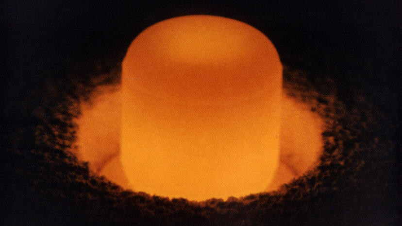A plutonium-238 oxide pellet glows from its own heat; the radioisotope is used as fuel to power spacecraft bound for deep space. U.S. Department of Energy