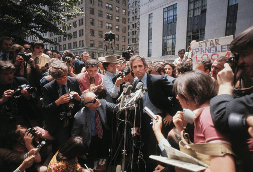 RAND Corporation researcher Daniel Ellsberg is surrounded by reporters at the Federal building, two days after he surrendered to Federal authorities on June 26, 1971. Ellsberg admitted supplying the New York Times with the secret Pentagon papers. Bettmann/Getty Images