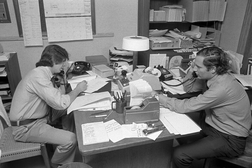 Carl Bernstein (L) and Bob Woodward (R) make phone calls before a radio show taping on June 17, 1974, in New York City. Both reporters were lauded for their uncovering of what came to be called the Watergate scandal. Waring Abbott/Getty Images