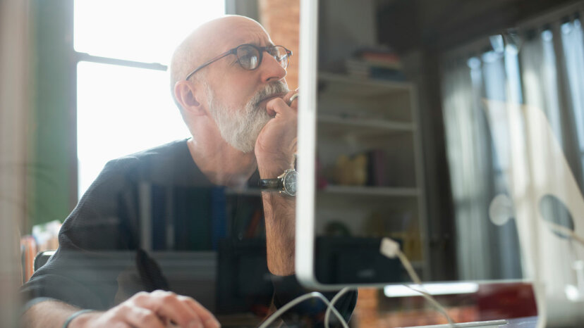 man looking at screen