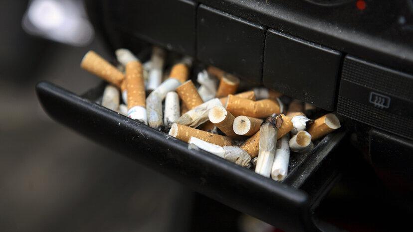 car ashtray full of cigarettes