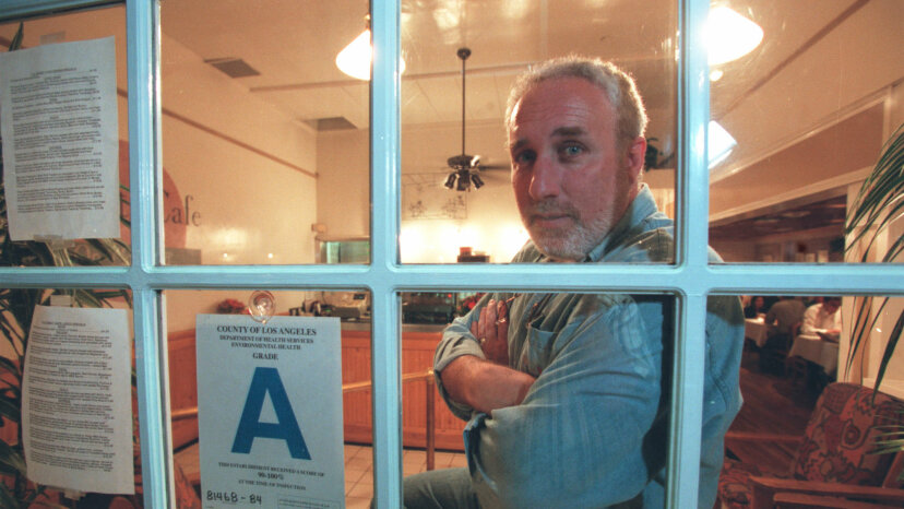 A Los Angeles restaurant owner is shown with his 'A' rating. Ron Bull/Toronto Star via Getty Images