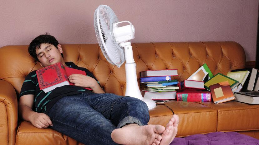 man sleeping with fan on