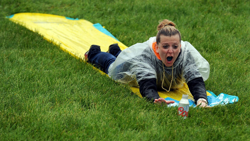 adult sliding down Slip 'N Slide