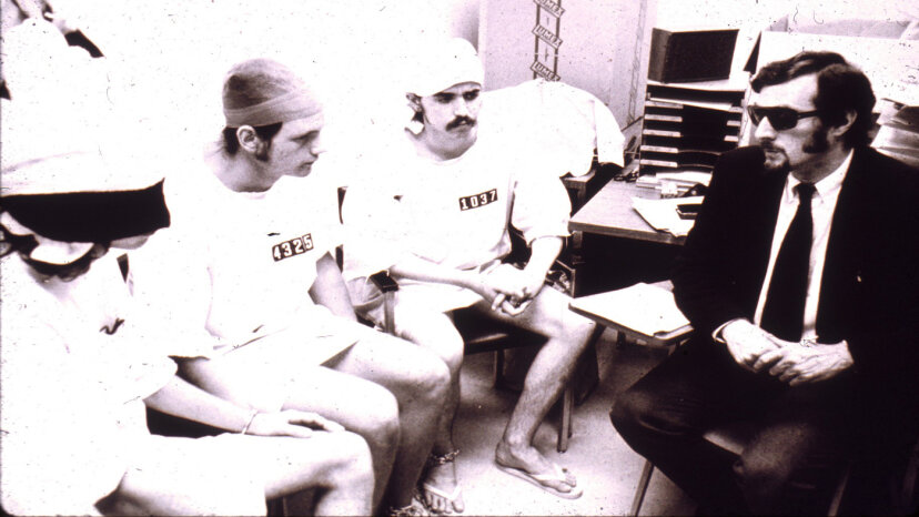 Some of the prisoners meet with Philip Zimbardo, the prison superintendent and lead researcher. Zimbardo admits that he shouldn't have played both roles. PrisonExp.org