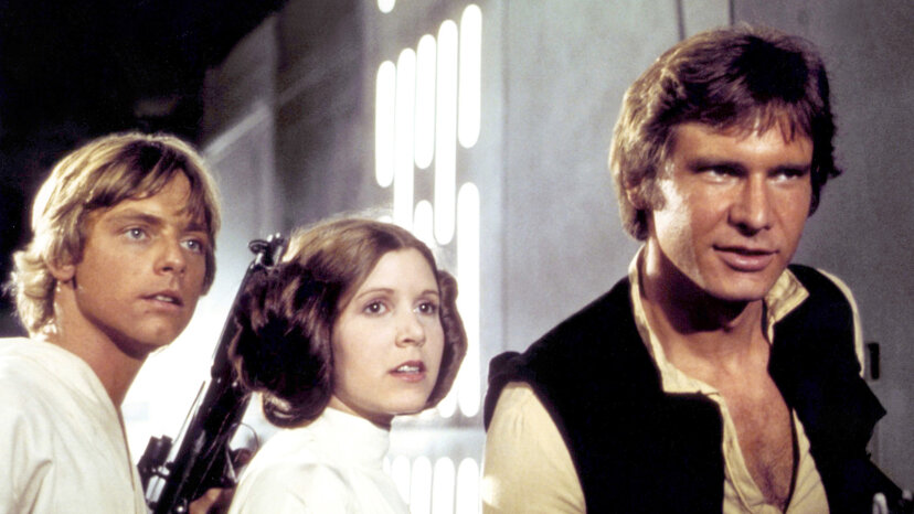 """Mark Hamill, Carrie Fisher and Harrison Ford on the set of """"Star Wars: Episode IV — A New Hope"""""""