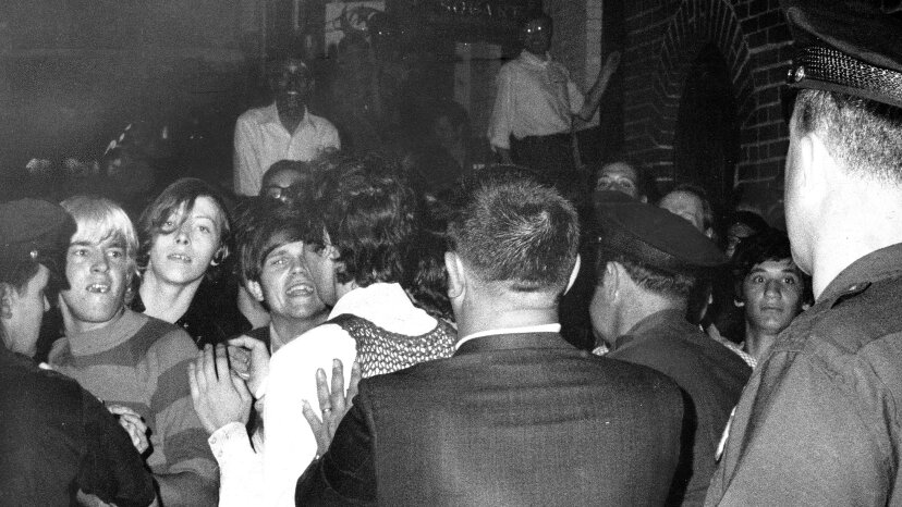 The crowd tries stop police arrests during the riots. NY Daily News Archive via Getty Images