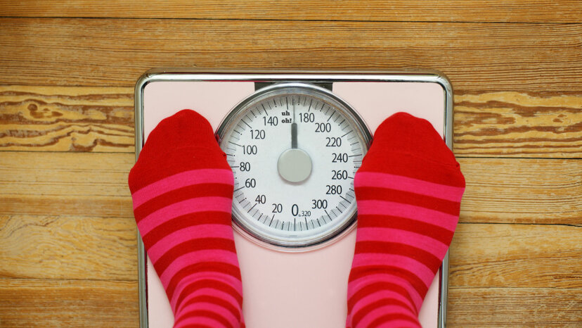 striped socks on a pink scale
