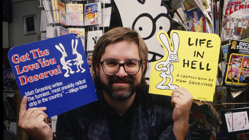 """The Simpsons"" creator Matt Groening holds up ads for his comic. George Rose/Hulton Archive/Getty Images"