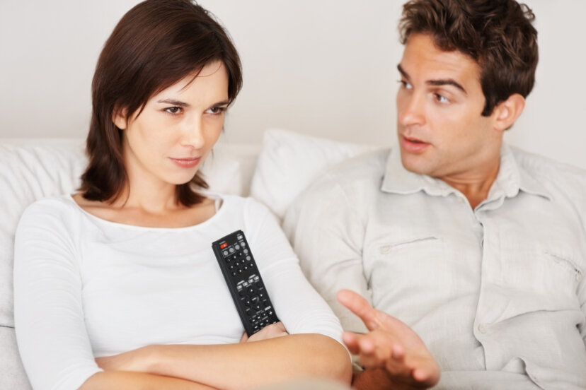 couple fighting  with tv remote