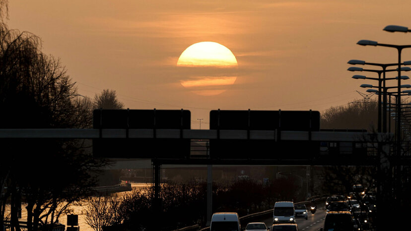 Vehicles move on at A-100 highway during sunset