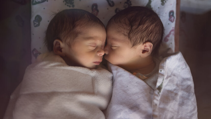 Male fraternal twin babies sleeping