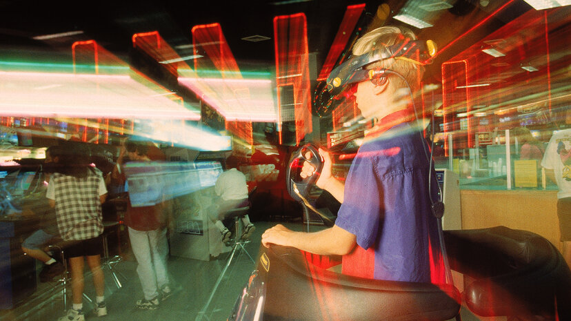 Sure, playing VR games by yourself might be fun, but it could be even more fun if your buddies are there cheering you on — or making fun of you. That communal gaming atmosphere is what's behind virtual reality arcades. Michael Hewes/Photolibrary/Getty Images