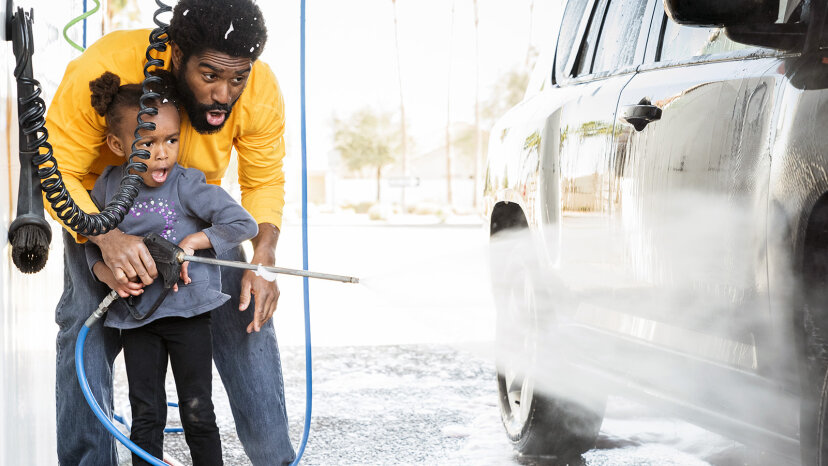 dad and daughter washing car