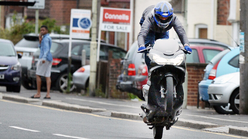 motorcyclist popping wheelie