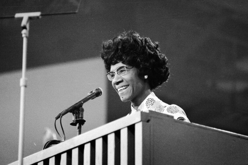 African American educator and U.S. Congresswoman Shirley Chisholm speaks at a podium at the Democratic National Convention in July 1972.