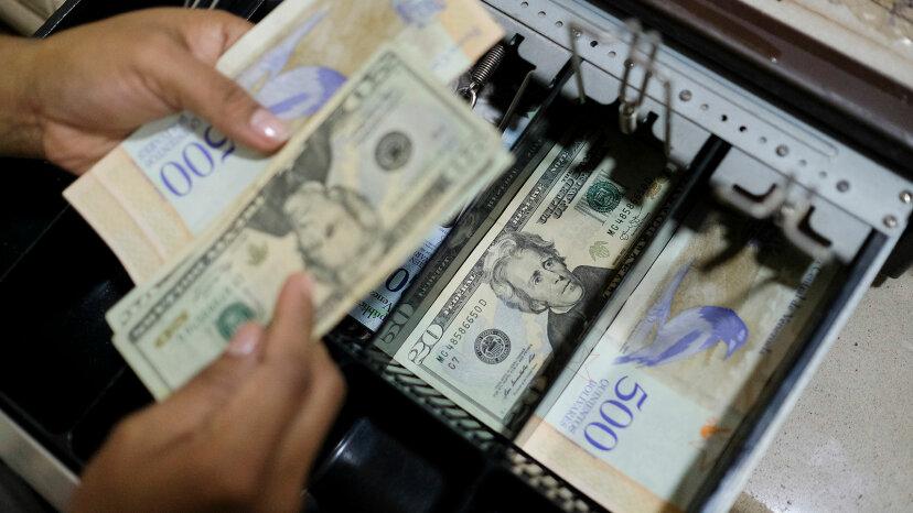 cash register drawer in Venezuela, U.S. 20 dollar bills.