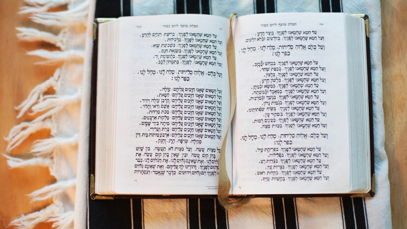 a siddur and tallit (prayer book and prayer shawl).