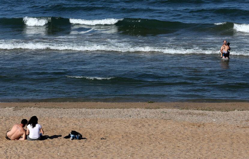 caspian sea, people swimming, russia