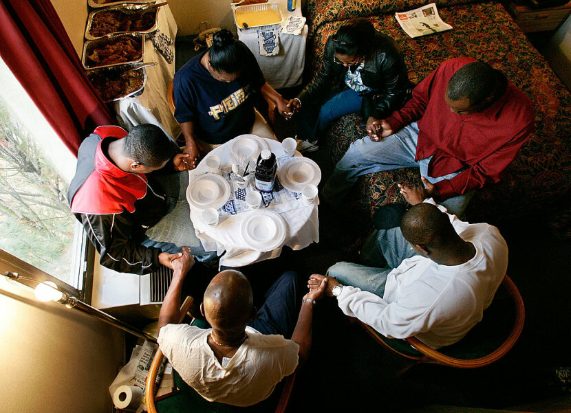 Hurricane Katrina evacuees dining for Thanksgiving in 2005
