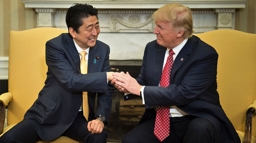 Japan's Prime Minister Shinzo Abe and Trump shake hands before a meeting in the Oval Office of the White House on Feb. 10, 2017. Based on this snapshot, it's hard to tell that anything strange is going down with the Abe-Trump handshake.
