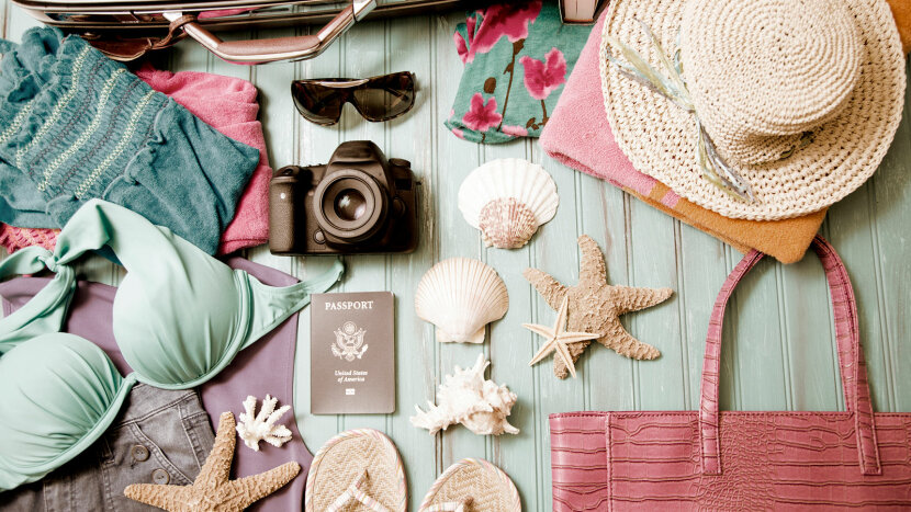 Items to put in a suitcase: straw hat, binoculars, camera, flip flops, shoes, sea shells, book,