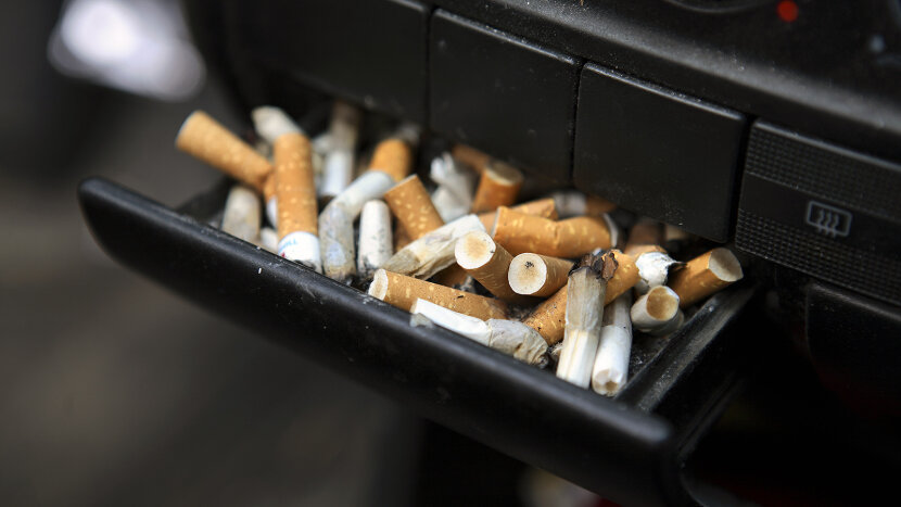 car ashtray full of cigarettes