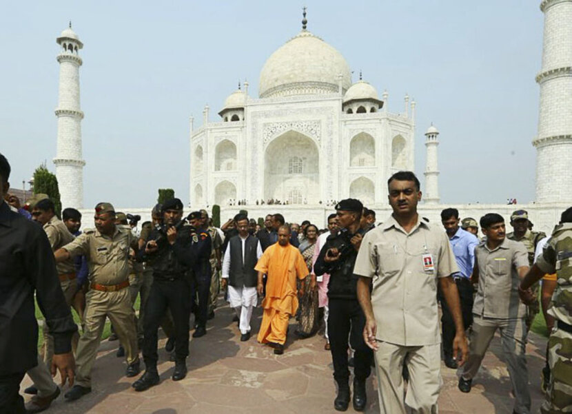 uttar pradesh chief minister yogi adityanath walks with a group in front of the taj mahal