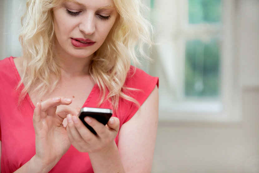 woman anxious holding smartphone