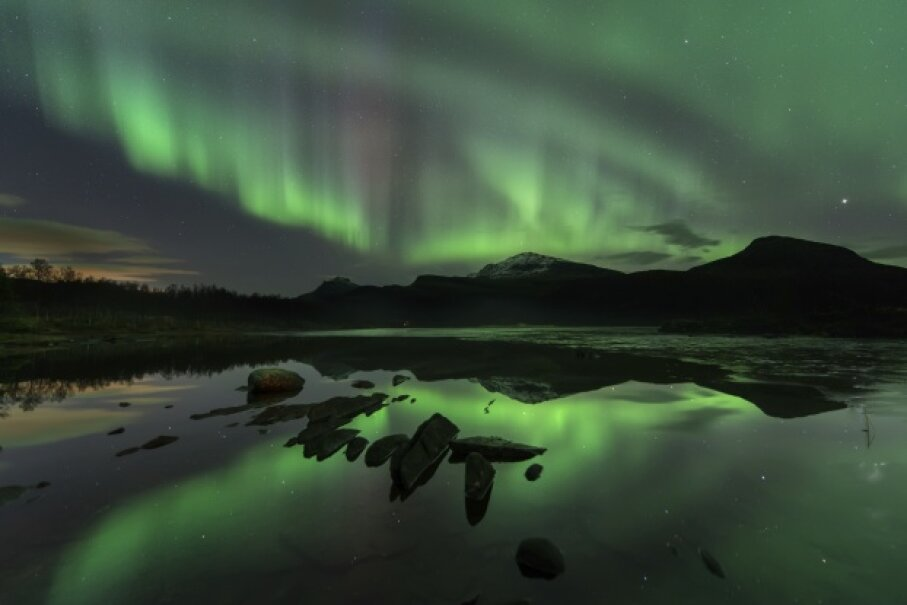 The green glow of the Northern Lights looks almost supernatural. iStockphoto/Thinkstock