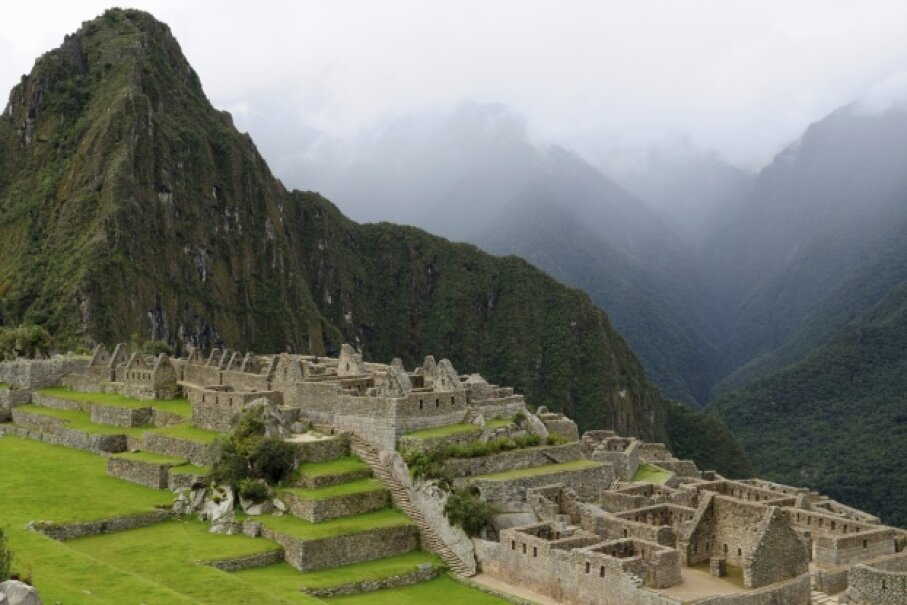 Machu Picchu shrouded in a cloud. iStockphoto/Thinkstock