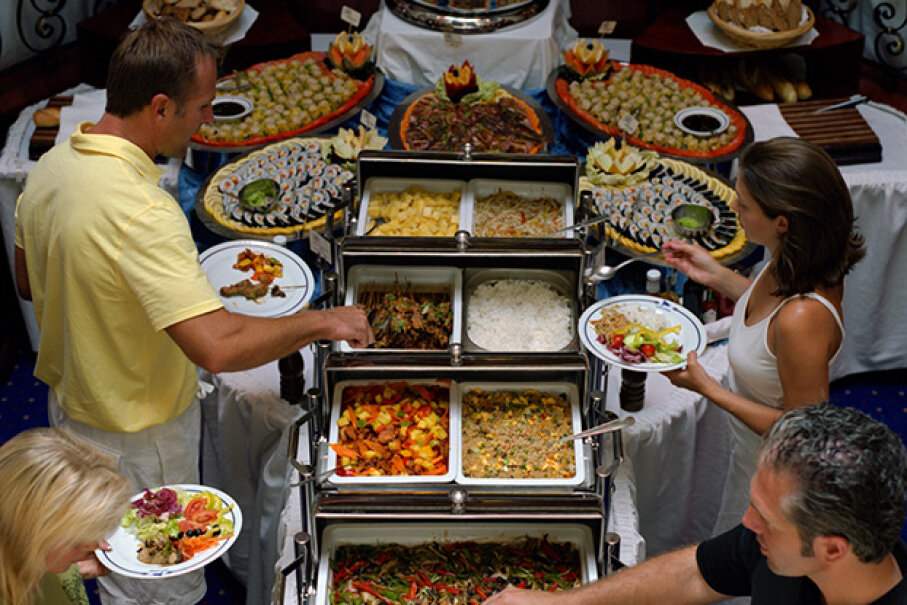 Overloading your plate and demanding more food at the office party is not only bad for your reputation -- it's bad news for your waistline, too. Creatas/Thinkstock