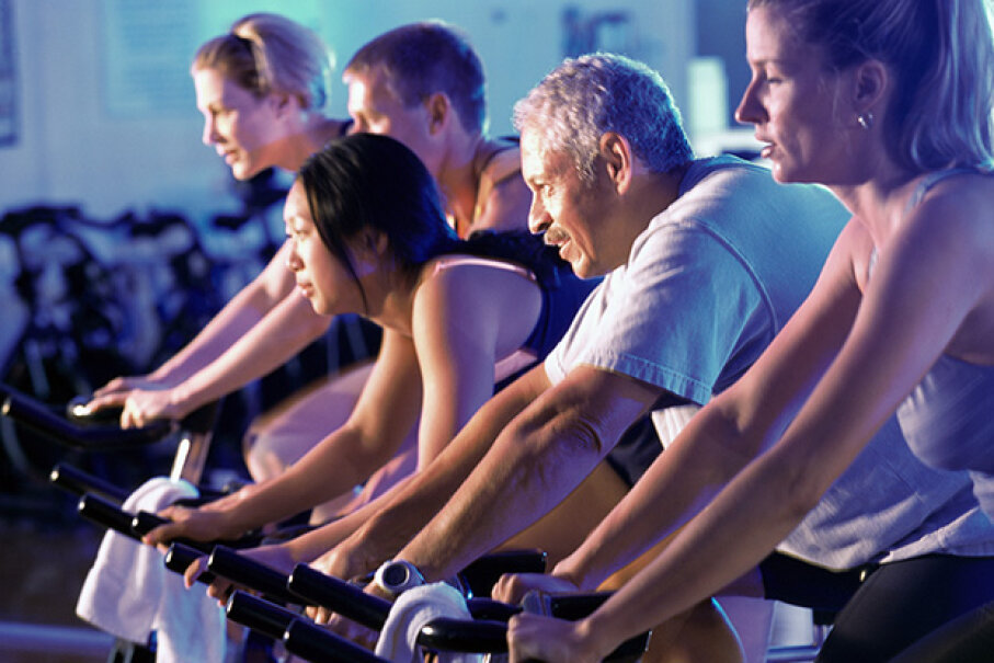 To help keep yourself and others from catching gym germs, wipe down your machine before and after hopping on. Purestock/Thinkstock