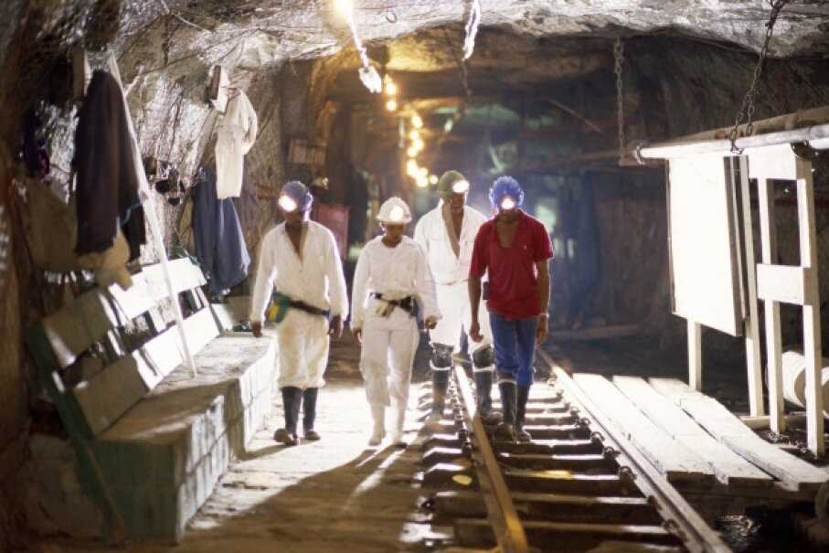 Miners walk through the Savuka gold mine in South Africa. © Michael S. Lewis/CORBIS