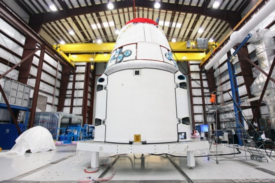 During one of its less exciting moments, SpaceX's Dragon capsule bides its time until it can rocket toward space once again. © NASA/Reuters/Corbis
