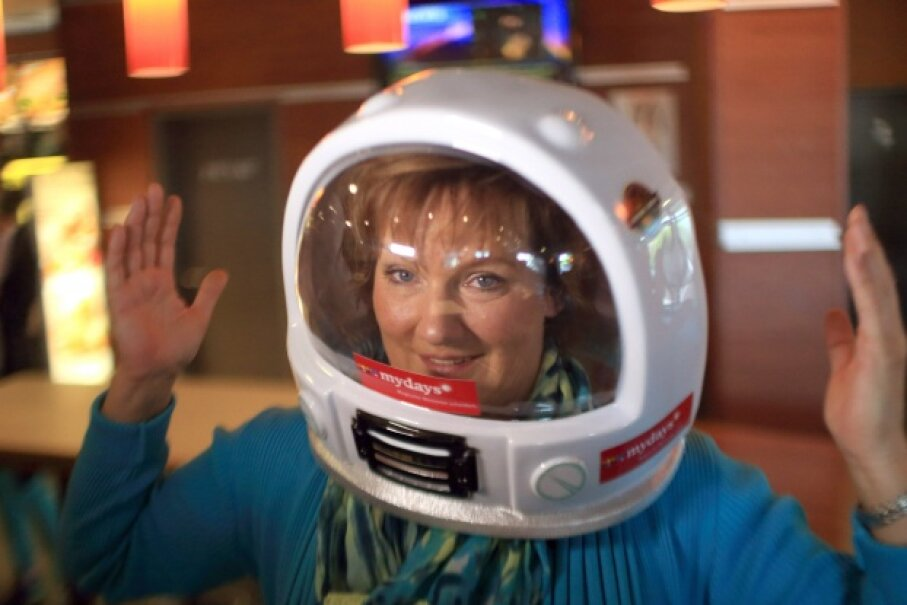 You can buy a seat to outer space, if your pockets are deep enough. Or you can win one at McDonald's, as Heike Duesterhoeft did in 2013. Her trip is slated for 2014. © Jens Wolf/dpa/Corbis