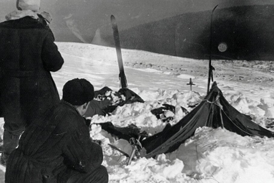 Investigators at the site of the Dyatlov Pass incident examine the campers' tent, which had been cut open from the inside.   Soviet investigation file photo