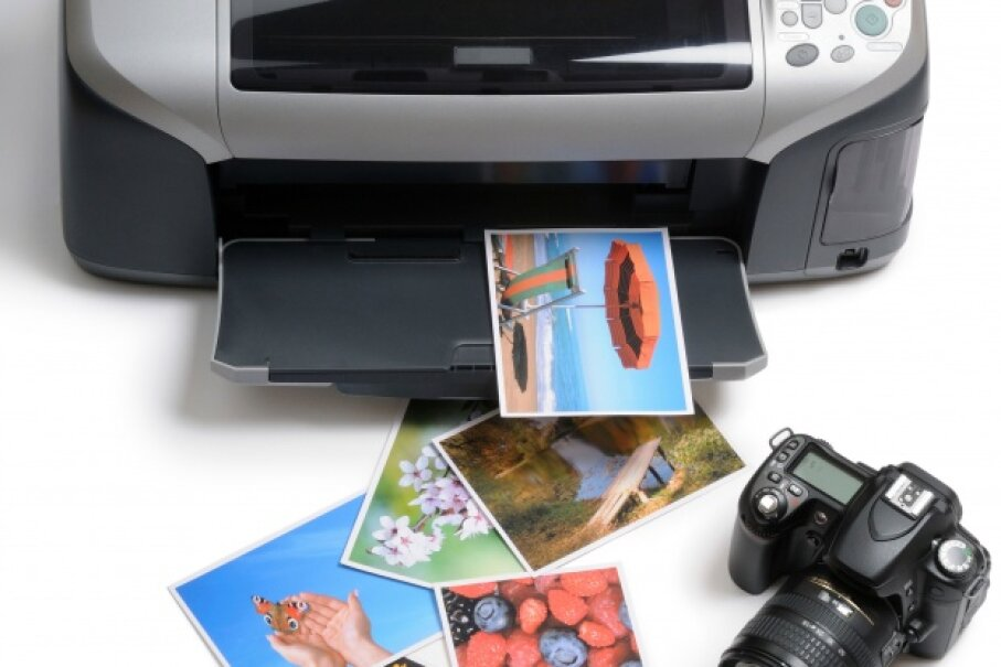 The money you spend printing your vacation photos at home could be funneled into your fund for your next trip instead.  ©lenta/iStockphoto