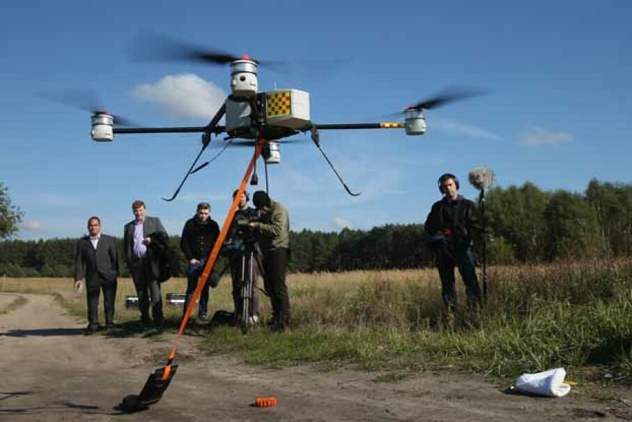 Journalists watch a quadrocopter drone with a device for marking telephone cables with artificial DNA take off in 2013. Deutsche Telekom is releasing drones across Germany to fight cable theft, which has shot up with the increasing value of copper. Sean Gallup/Getty Images