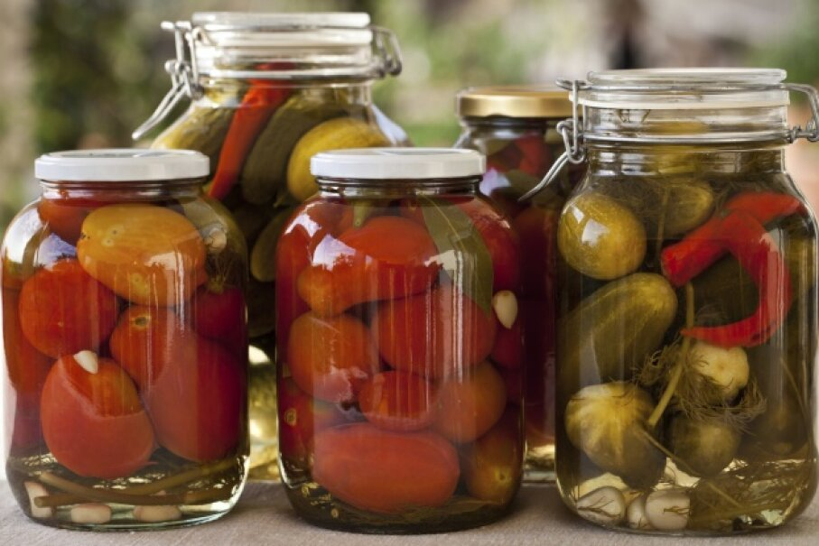 Without the ability to preserve food through canning and other means, humans would have a much harder time adequately feeding themselves. iStock/Thinkstock
