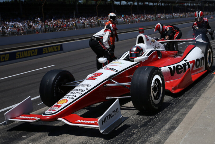 Juan Pablo Montoya comes in for a pit stop during the 98th running of the Indianapolis 500 Mile Race at Indianapolis Motor Speedway on May 25, 2014. (Chris Graythen/Getty Images)