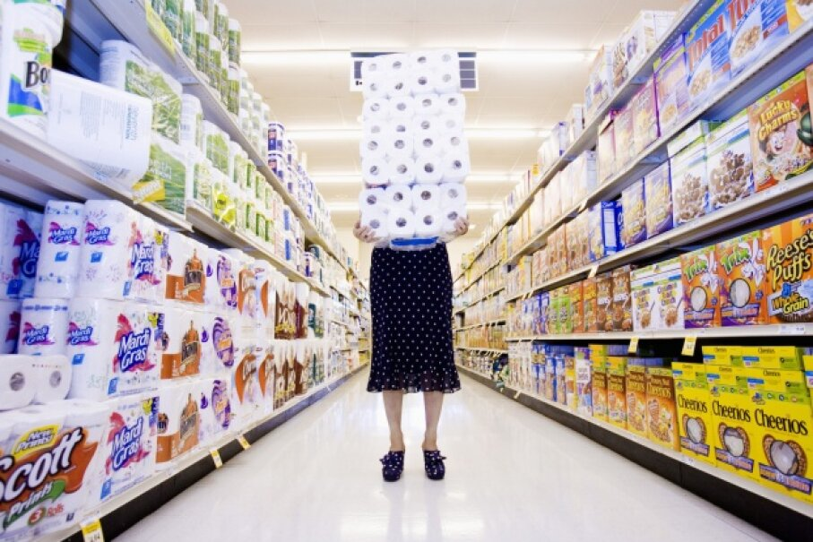 You can save as much as 50 percent on paper towels and toilet paper when you buy them in bulk. Big Cheese Photo/Thinkstock