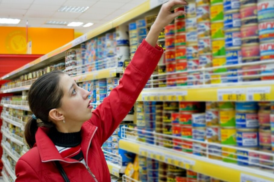 Canned food usually has a long shelf life, so it's a good item to stock up on. Hemera/Thinkstock