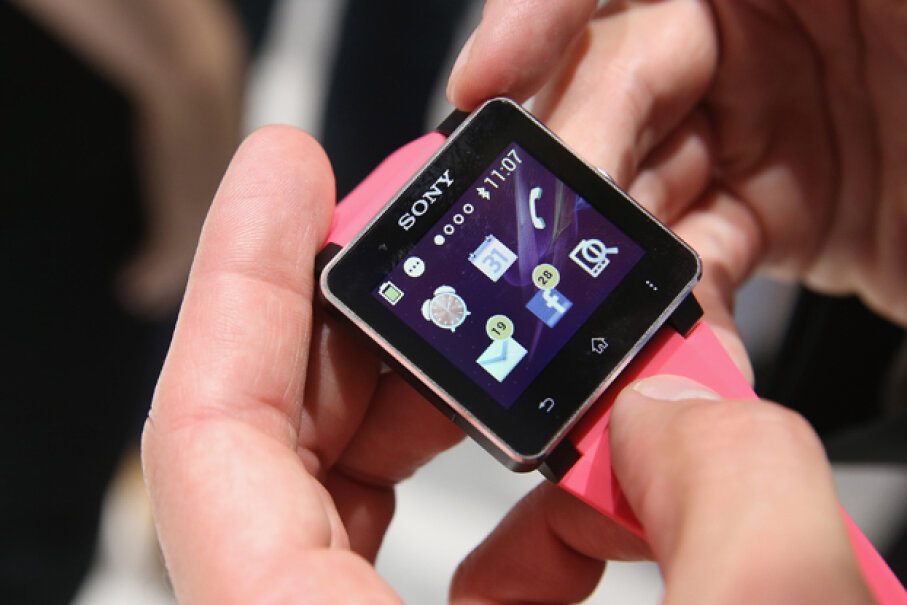 Visitors try out the SW2 smartwatch at the Sony stand at the IFA 2013 consumer electronics trade fair in Berlin, Germany. (Sean Gallup/Getty Images)