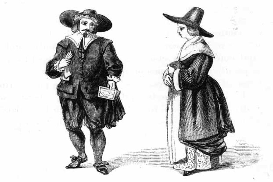 A woodcut showing a couple in traditional Puritan dress. MPI/Getty Images